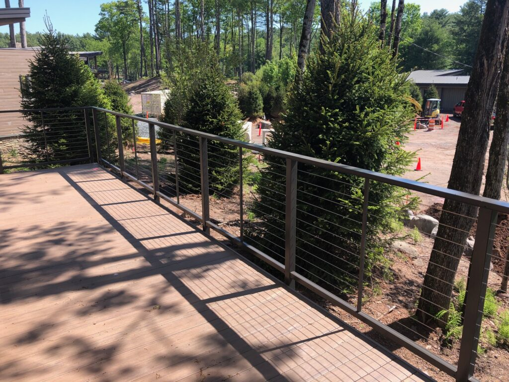 railing and deck next to trees
