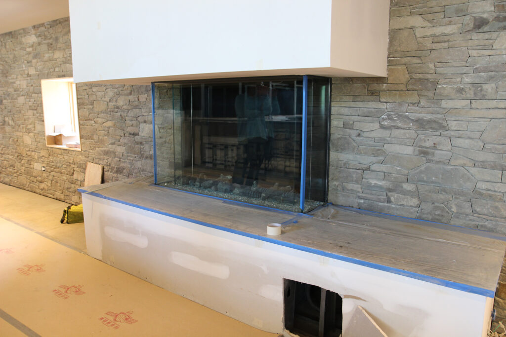 glassed in fireplace set in stone wall