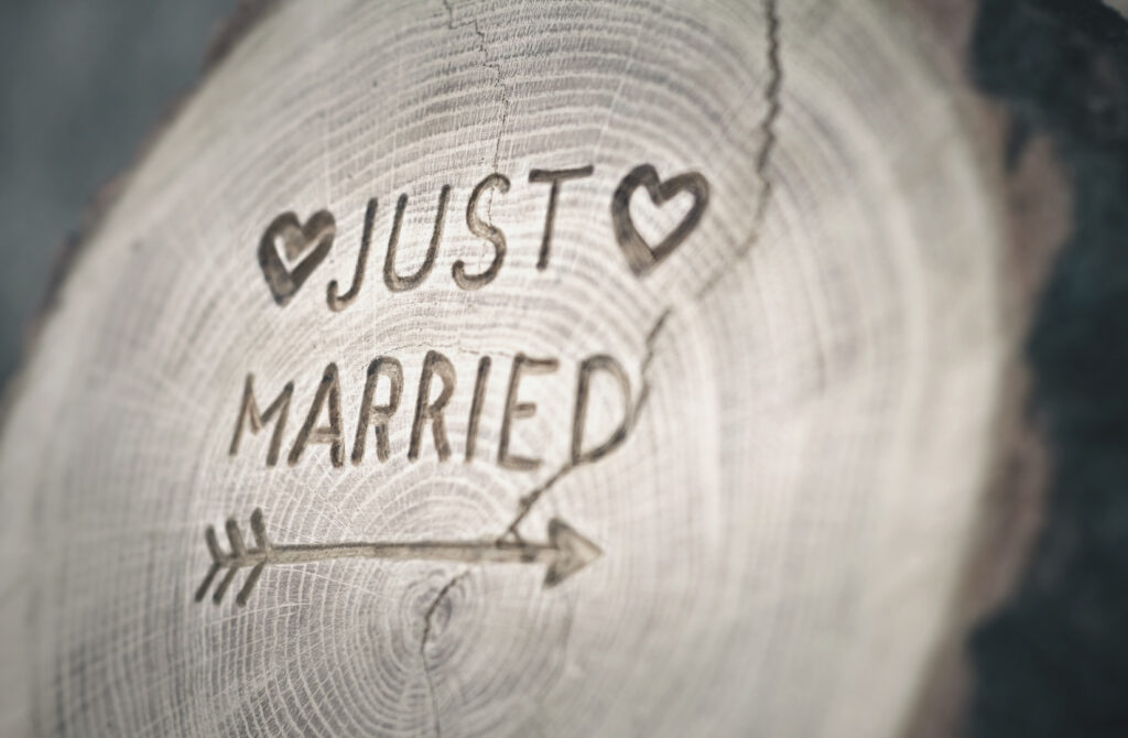 Just married carved into wood